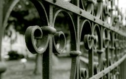 Metal fence in mystical retouch and side perspective Royalty Free Stock Image