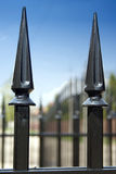 Metal fence over blue sky Stock Photography