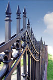 Metal fence over blue sky Royalty Free Stock Photos
