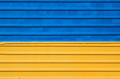 Metal fence painted in blue and yellow colors of Ukrainian flag. Metal fence painted in colors of Ukrainian flag Stock Photo