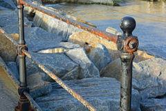 Metal fence post. A photo of a metal fence post and railing Royalty Free Stock Photo