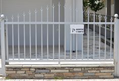 Metal fence of private house. With sign Royalty Free Stock Photo