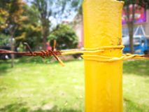 Metal fence with red corrosion and yellow painting Stock Images