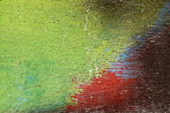 Metal fence  with red,green,blue,white and black paint Royalty Free Stock Photo