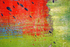 Metal fence  with red,green,blue,white and black paint Royalty Free Stock Photography