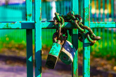 Metal Fence with Rusty Lock and Chain Stock Images