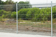 Metal fence. Security fence at the side of the land royalty free stock image