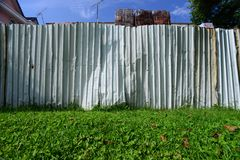 Metal fence separating two neighbours Royalty Free Stock Photos