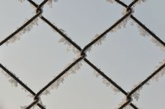 Metal fence with snow Stock Photo
