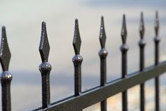 Metal fence with spikes. Picture with shallow depth of field Stock Photo