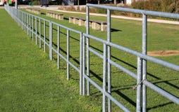 Metal fence. Metal fence at the stadium. Metal fence. Metal fence at the stadium stock photos