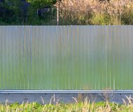 Metal fence on the summer cottage as a background.  royalty free stock photo