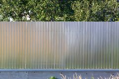 Metal fence on the summer cottage as a background.  stock photos