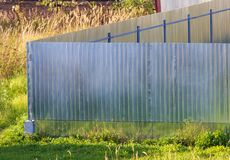 Metal fence on the summer cottage as a background.  royalty free stock photos