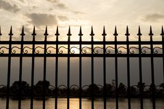Metal fence at sunset Stock Image