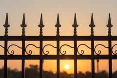 Metal fence at sunset Royalty Free Stock Photography