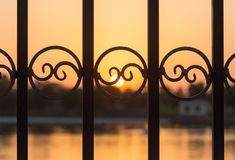Metal fence at sunset Royalty Free Stock Photos