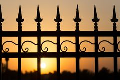 Metal fence at sunset Royalty Free Stock Images