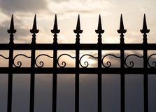 Metal fence at sunset Stock Images