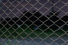 Metal fence tonight Stock Photo