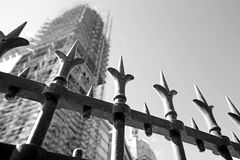 Metal fence with under construction building blur background. In black and white royalty free stock images