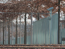 Metal fence with video cameras. Metal fence around private property with video cameras Stock Photos