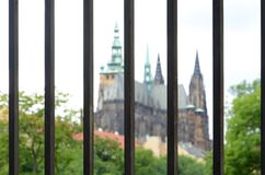 Metal fence with a view of the Cathedral of St. Vitus. Metal fence close up. Royalty Free Stock Images