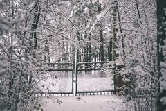 metal fence in winter - vintage film effect stock photography