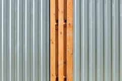 Metal Fence with Wood Inserts Royalty Free Stock Photos