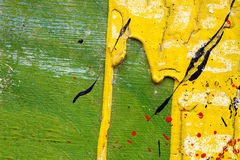 Metal fence with yellow, green, red and black paint Royalty Free Stock Photography