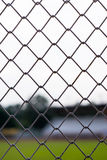 Metal fences with blur stadium background Royalty Free Stock Images