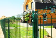 Metal fencing with modern house outdoor. Metal fence design. Fencing Stock Photography