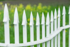 Metal fencing with sharp tips on the park background. Metal fencing with sharp tips on the park background royalty free stock image