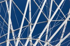 Metal Ferris wheel against the blue sky.  Stock Photography