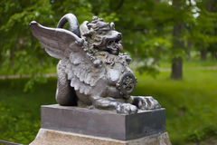 Metal figure of winged dragon on the Bridge in the Alexander Park. Tsarskoye Selo, St. Petersburg, Russia. Royalty Free Stock Images