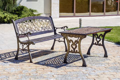 Metal filigree bench and table. Near hotel Royalty Free Stock Photos