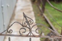 Metal Filigree on fence post. Bisbee, AZ/USA - 03-13-2019:  Close up on the metal Filigree on a fence post royalty free stock photos