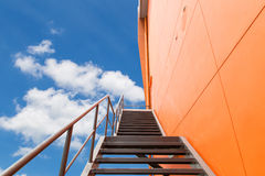 Metal fire escape or emergency exit on Orange Wall of Buliding Royalty Free Stock Photo