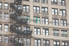 Metal fire escape outside apartment building for emergency Stock Image
