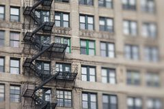 Metal fire escape outside apartment building for emergency Royalty Free Stock Image