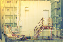 Metal fire escape outside building . ( Filtered image processed Stock Photography