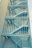Metal fire escape outside building . ( Filtered image processed Royalty Free Stock Images