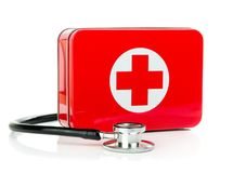 A metal first aid box and stethoscope Royalty Free Stock Image