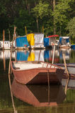 METAL FISHING BOAT ON THE RIVER Stock Photo