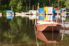 METAL FISHING BOAT ON THE RIVER Royalty Free Stock Photo