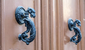 Metal door locks. Metal fittings on ancient medieval wooden door Royalty Free Stock Photos