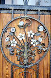 Metal fittings on ancient medieval wooden door. Ornament twirly metal fittings on ancient medieval door stock images