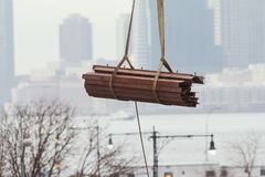 Metal fittings on the building crane on the background of the urban landscape Stock Photo