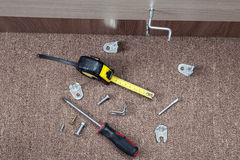 Metal fittings, clamps and hand tools for installing furniture. Stock Images