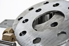 Metal flanges and brass nuts. Milling industry. Close-up. Royalty Free Stock Photo